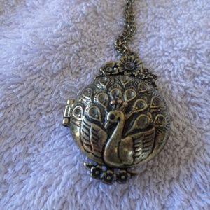 Vintage peacock locket